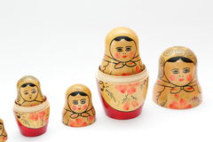 arranged close doll family hand like looking matryoshka nested painted together unique upwards which white wooden Royaltyfri Fotografi