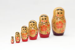 arranged close doll family hand like looking matryoshka nested painted together unique upwards which white wooden Royaltyfria Foton