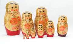 arranged close doll family hand like looking matryoshka nested painted together unique upwards which white wooden Arkivbilder