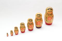 arranged close doll family hand like looking matryoshka nested painted together unique upwards which white wooden Fotografering för Bildbyråer