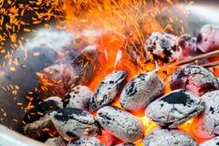 Arranged coals selective focus ready for barbecue royalty free stock photos