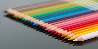 Arranged colored wood pencils lying stock photography
