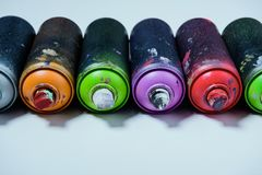 Arranged colorful spray paint in cans. Close up view of arranged colorful spray paint in cans stock photos