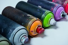 Arranged colorful spray paint in cans. Close up view of arranged colorful spray paint in cans stock photo