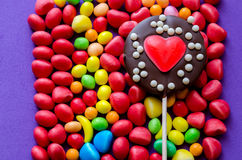 Arranged colorful sweets with chocolate heart lollipop Stock Photo