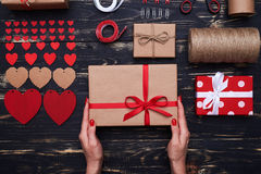 Arranged decorative stuff with a gift box in hands Stock Photography
