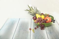 Arranged fruit bowl on the table. Healthy fruit background ; Studio photo of different fruits on white and  blue  vintage wooden table , high resolution product Stock Photos