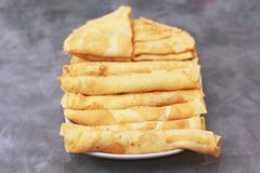Arranged pancakes. Filled pancakes with chocolade and marmalade stock image