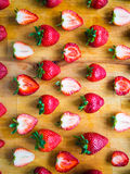 Arranged pattern of strawberries on a wooden board. Arranged fresh strawberries on a wooden board Royalty Free Stock Photography