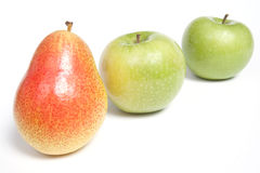 Arranged pear and green apples Royalty Free Stock Photography