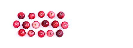 Arranged red ripe cranberries isolated on white. Macro view ripe forest berries, cut out background, copy space. Arranged red ripe cranberries isolated on white royalty free stock photos
