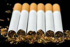 Arranged in a row cigarettes Royalty Free Stock Photography