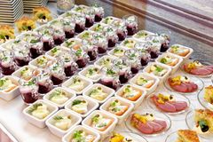 Arranged selection of canapes on white table. royalty free stock photography