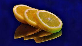 Arranged sliced lemon with reflection in glass royalty free stock photo