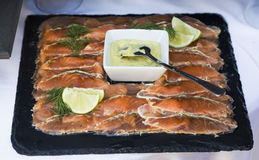 Arranged smoked salmon on a plate Stock Photos