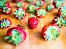 Arranged strawberries on a wooden board. Arranged fresh strawberries on a wooden board Royalty Free Stock Photography
