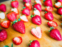 Arranged strawberries on a wooden board. Arranged fresh strawberries on a wooden board Stock Photos