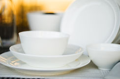 Arranged table with dishes. Arranged table with several different kind dishes Royalty Free Stock Photos