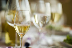 Arranged table with glasses. Arranged table with several different kind glasses Stock Photo