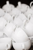 Arranged white coffee cups in pattern. Ready for morning coffee Stock Image