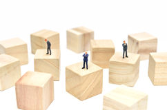 Arranged Wood cube and Businessman. Stock Photography