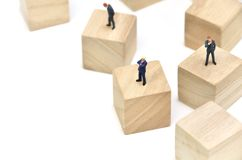 Arranged Wood cube and Businessman. Royalty Free Stock Photo