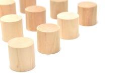 Arranged Wood Cylinder on white background. Royalty Free Stock Images