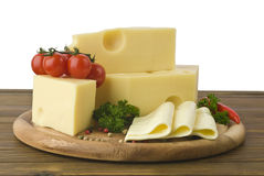 Arrangement with appetizing cheese on the kitchen cutting board Royalty Free Stock Photo