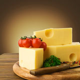 Arrangement with appetizing cheese on the kitchen cutting board Royalty Free Stock Photography
