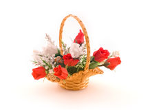 Arrangement of artificial flowers. In braided basket Stock Photography