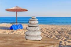 Arrangement of balance pebble stone like symbol of spa harmony. With sea background Royalty Free Stock Images