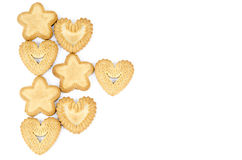 Arrangement of biscuits. Bakery - Star and heart shaped biscuits - Isolated on white - Abstract background Royalty Free Stock Images