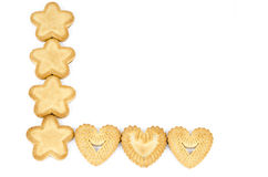 Arrangement of biscuits. Bakery - Star and heart shaped biscuits - Isolated on white - Abstract background Royalty Free Stock Photography