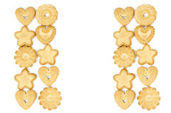 Arrangement of biscuits. Bakery - Star and heart shaped biscuits - Isolated on white - Abstract background Stock Photography