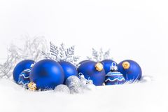 Arrangement of blue Christmas ornaments. On tray with white background Royalty Free Stock Photos