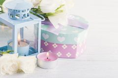 Arrangement of blue lanter, flowers, pastel gift box Stock Image