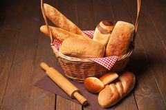 Arrangement of bread in basket and rolling pin Stock Photo