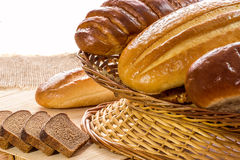 Arrangement of bread in basket  on wooden table Stock Images
