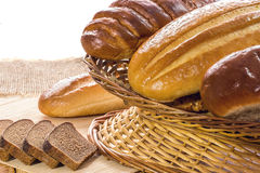 Arrangement of bread in basket  on wooden table Royalty Free Stock Photography