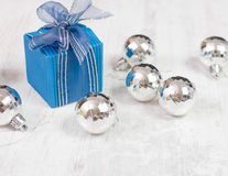 Arrangement with bue gift box and silver baubles Stock Image