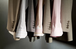 Arrangement of business clothes on hangers Royalty Free Stock Images