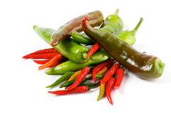 Arrangement of Chili Peppers. Arrangement of Big and mini green and red Chili Peppers isolated on white background Royalty Free Stock Image