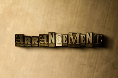 ARRANGEMENT - close-up of grungy vintage typeset word on metal backdrop. Royalty free stock illustration.  Can be used for online banner ads and direct mail Stock Photo