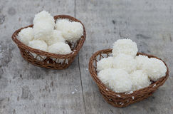 Arrangement of coconut cookies. On brown baskets Stock Image