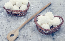 Arrangement of coconut cookies. On brown baskets and wooden spoon royalty free stock photography