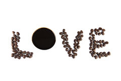 Arrangement of coffee beans in word love. Stock Photo