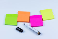 Arrangement of colored sticky notes with marker pen Royalty Free Stock Photography