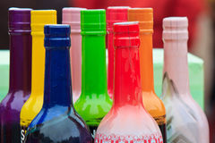 Arrangement of colored wine bottles Royalty Free Stock Images