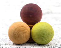 Arrangement of colored wooden balls. On background Royalty Free Stock Photo