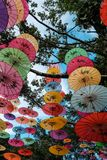 Decorative chinese umbrella. Arrangement of colorful chinese umbrella hanging in row use for decoration Stock Photography